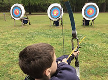 Boy Shooting Arrows