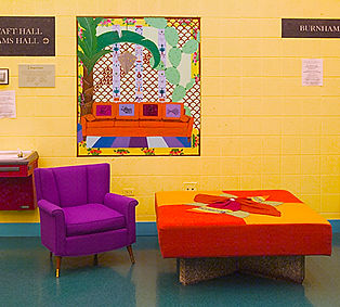 Vintage purple archair, giant ottoman with granite base, pop art painting of orange couch and palm tree at UIC Study Area