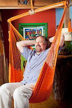Mark Anderson in orange hammock swing in ASSH Creativity Room