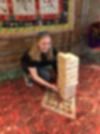 Woman with giant Jenga game