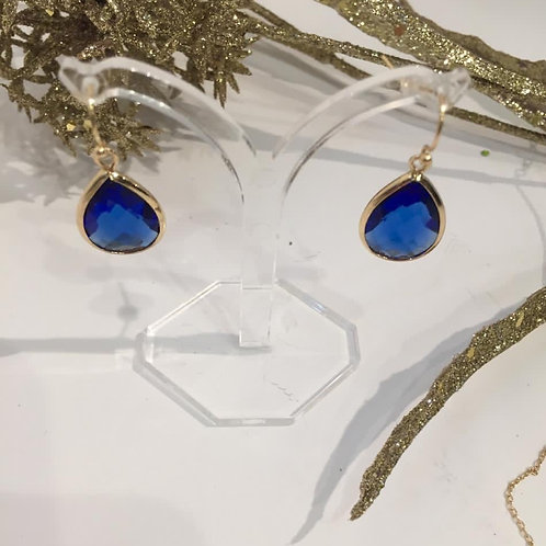 Fashion gold earings with a blue stone