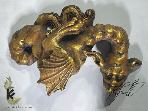 carved resin dragon