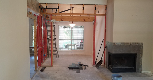 Tearing out two walls to create open concept.