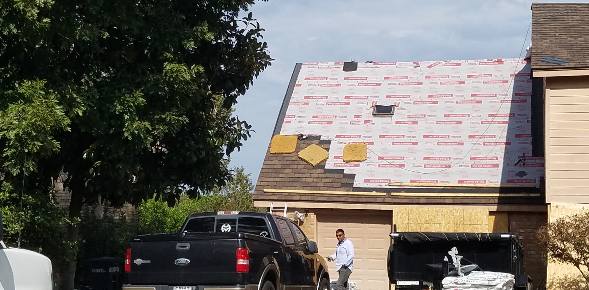 Camelot II Shingles being installed.
