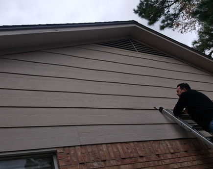 This siding will be replaced with Hardie Plank siding.