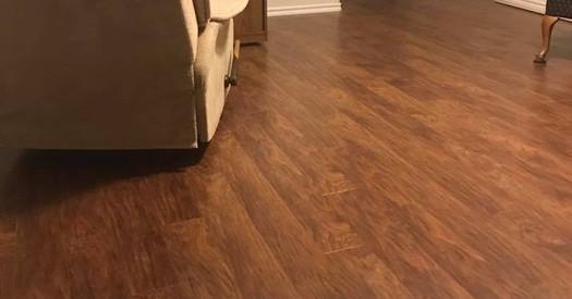 New wood look (embossed) laminate floors installed