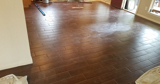 New tile floors extended into kitchen.