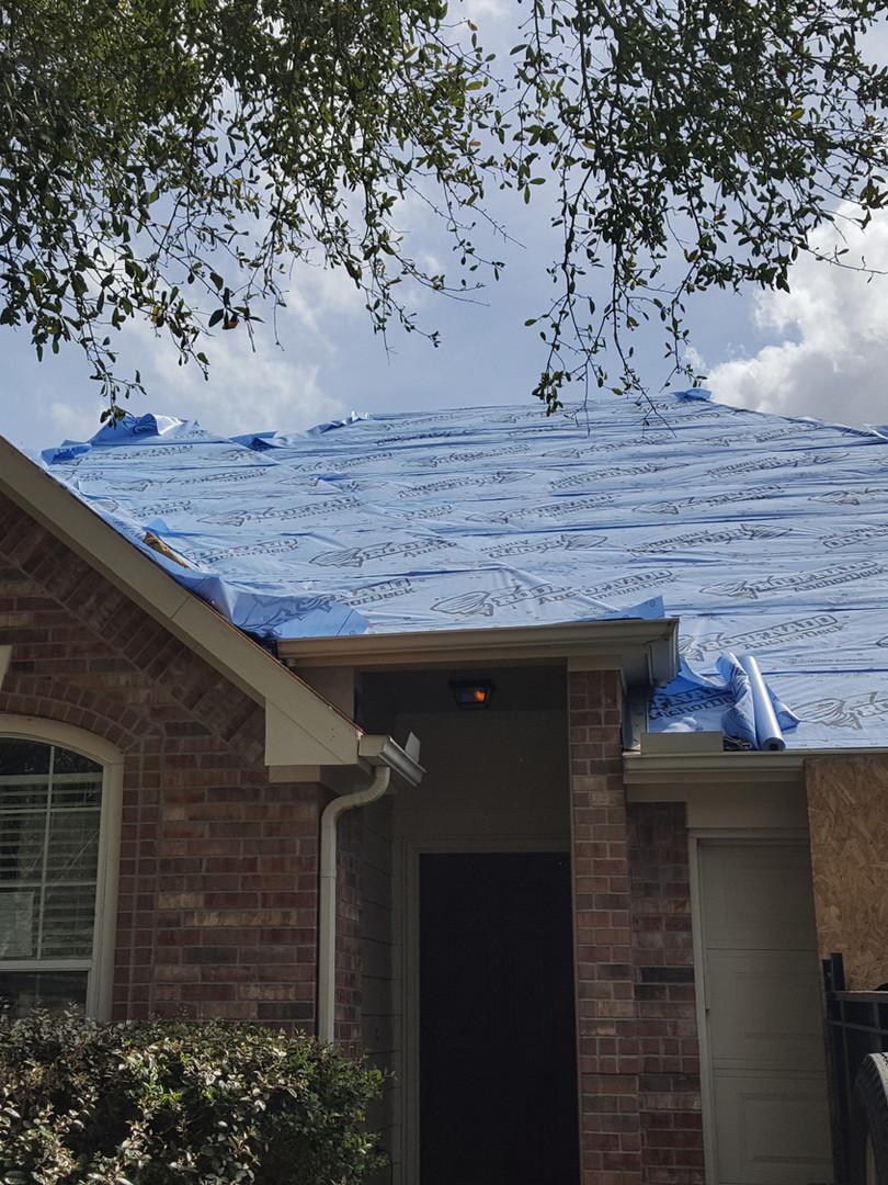 Preparing to shingle roof.