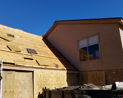 Shingles and paper stripped off down to decking.