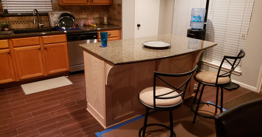 Kitchen with new floors and new large island.