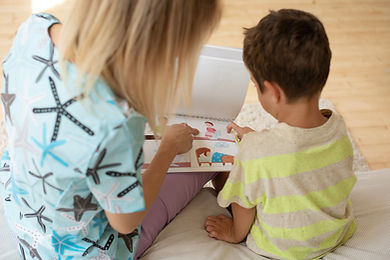 therapist-plays-educational-game-with-child-using-logic-cards.jpg