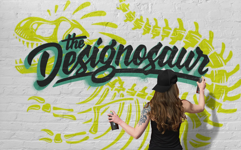 Artist spraypainting a brick wall with her logo