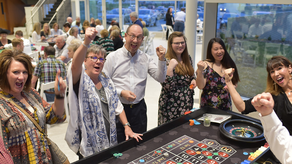 Group of people having fun at the roulette table
