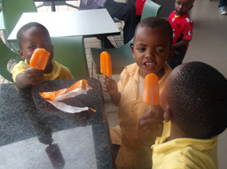 children and ice lollies