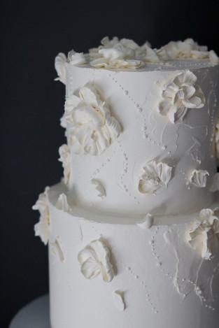 white wedding buttercream cake .jpg