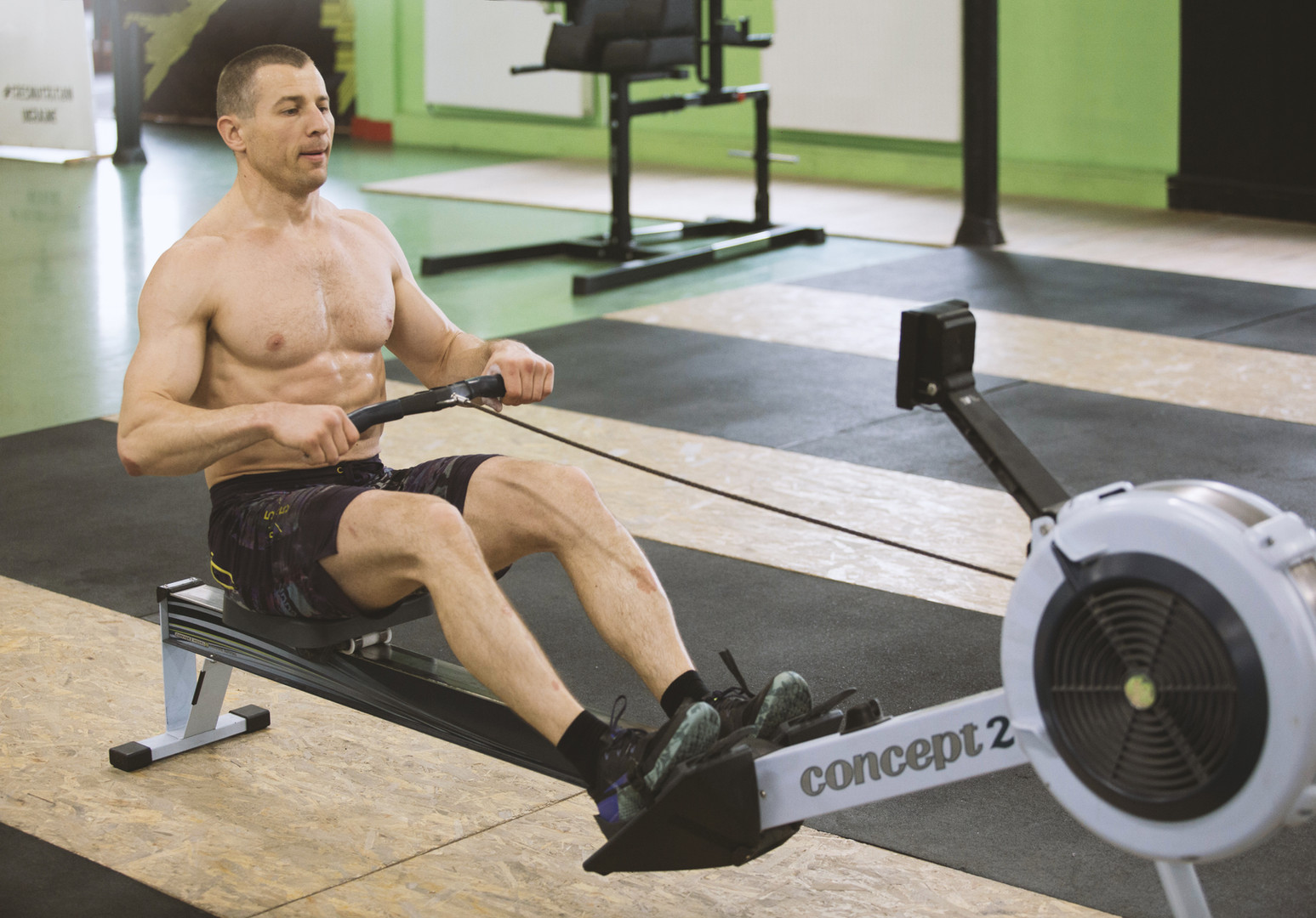 Man Working Out on a Machine