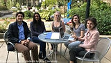 A group of students sitting at a cafe table