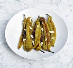 Green chilli peppers fried in olive oil with garlic