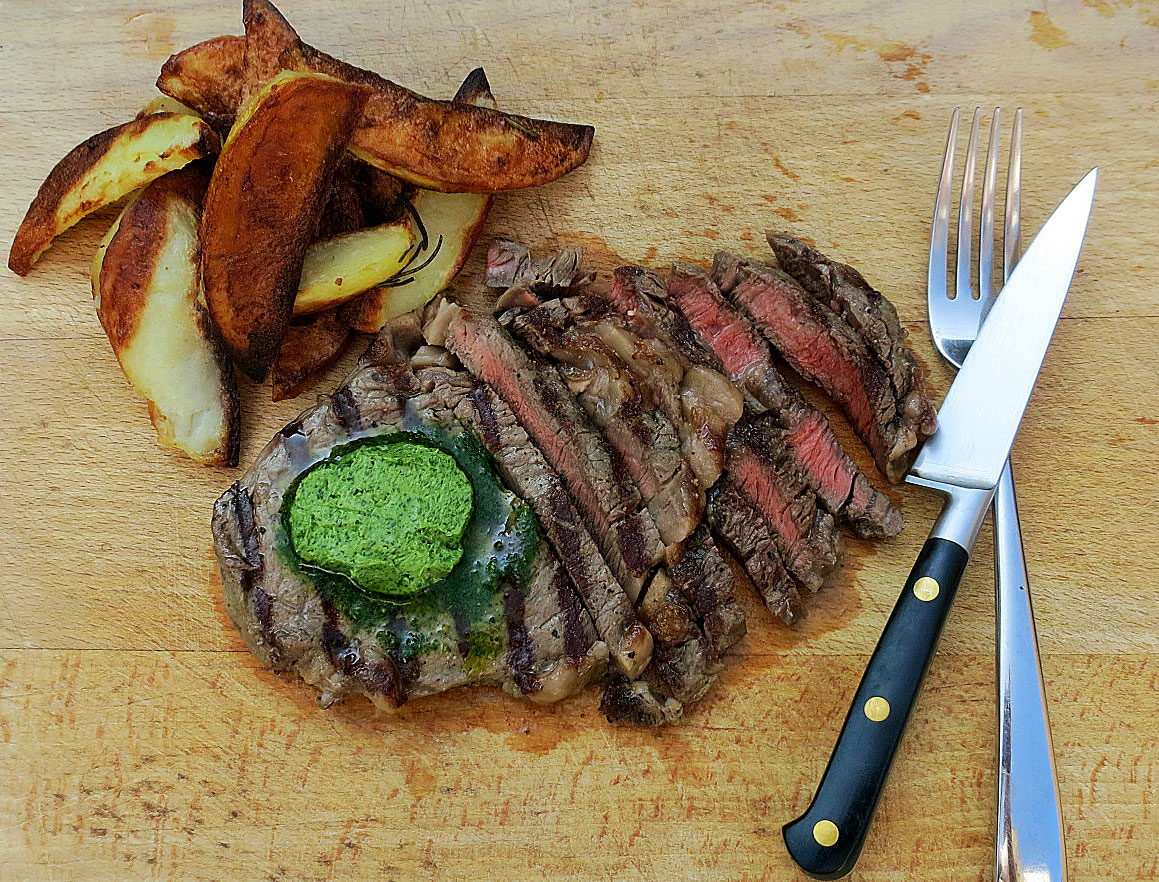 Rib eye steak with tarragon, parsley and garlic butter