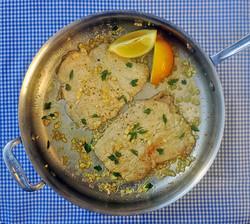 Flattened pork with garlic and lemon