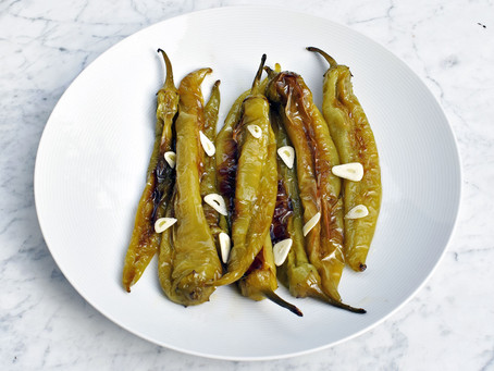 Mild green chilli peppers fried in olive oil with garlic