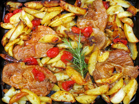 Pork shoulder steaks with paprika, potatoes, onions, garlic & rosemary