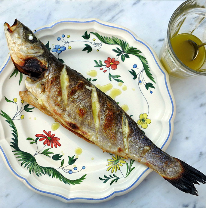 Sea bass with lemon, garlic and olive oil