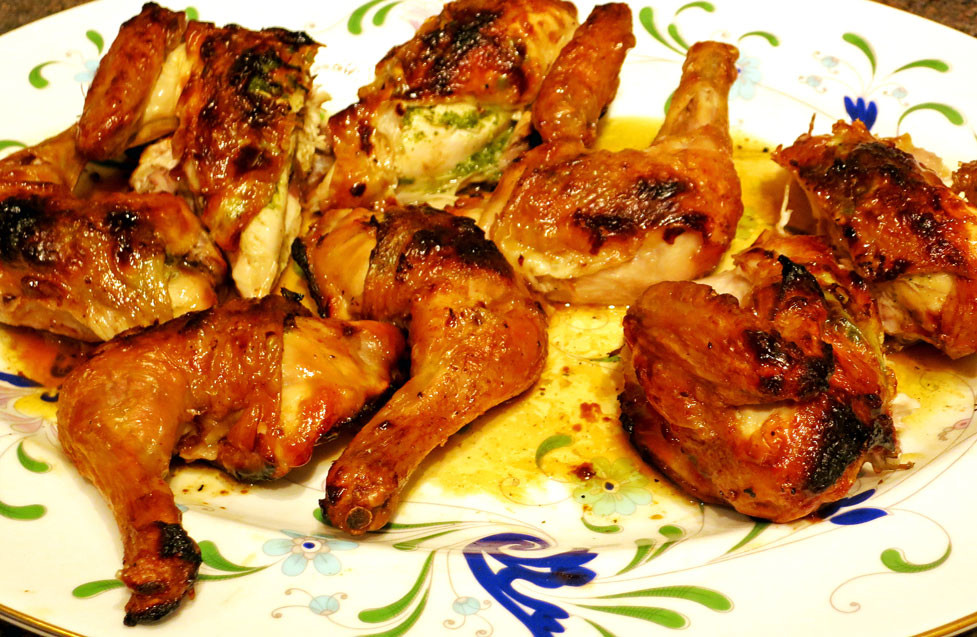Spatchcock Poussin with tarragon, parsley and garlic butter