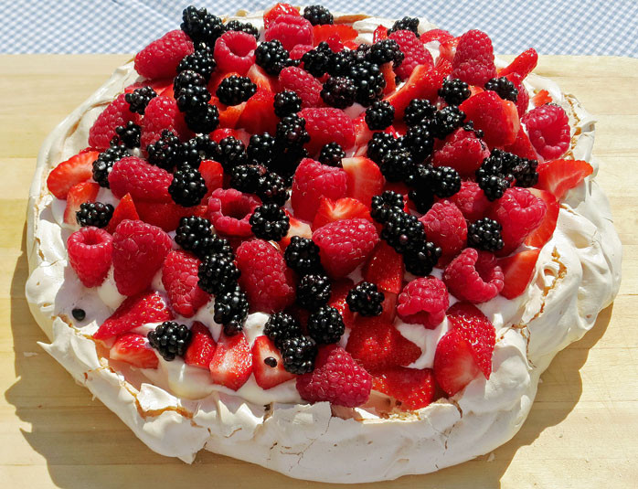 Pavlova with berries and whipped cream (meringue)