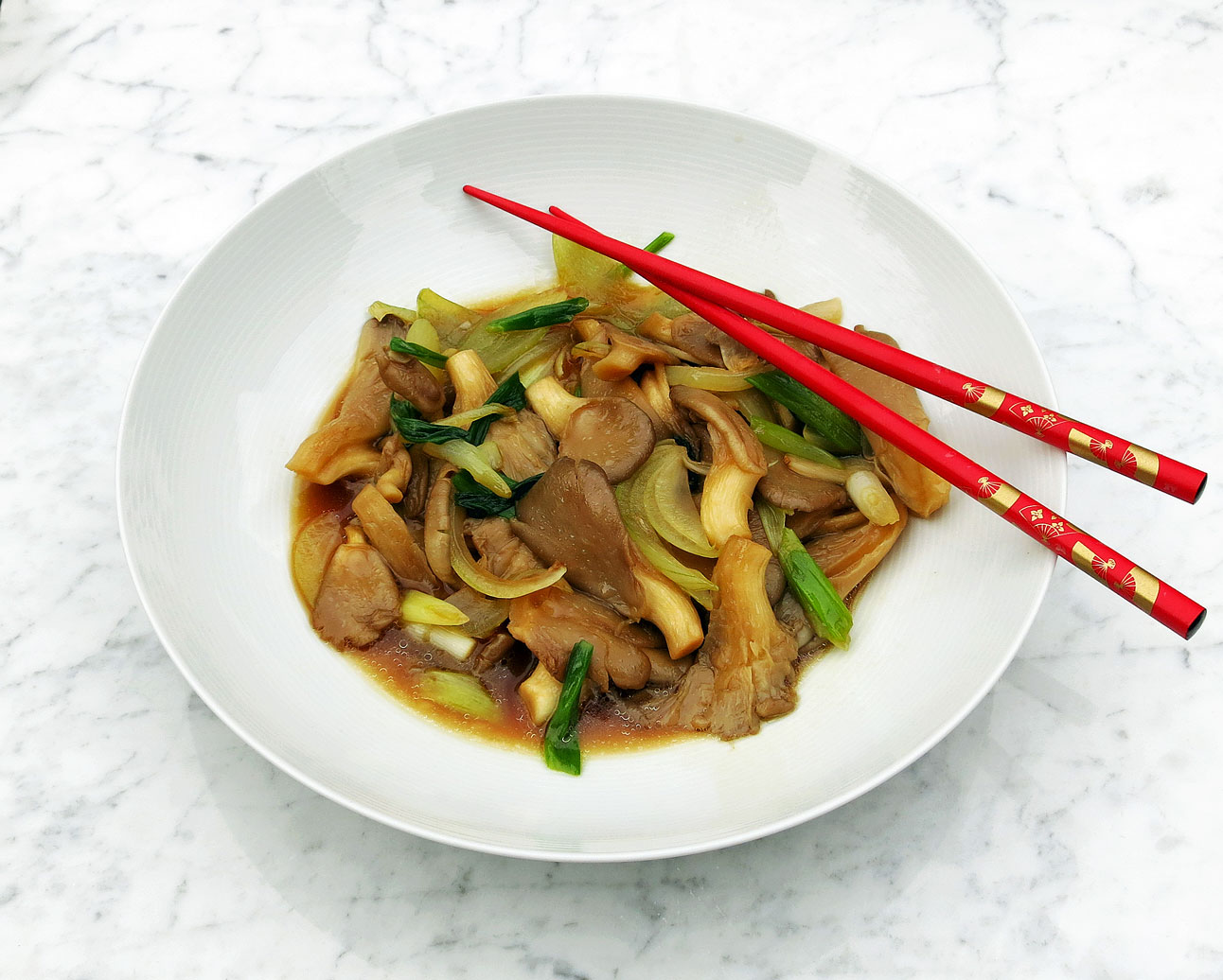 Stir fry Chinese oyster mushrooms and spring onions
