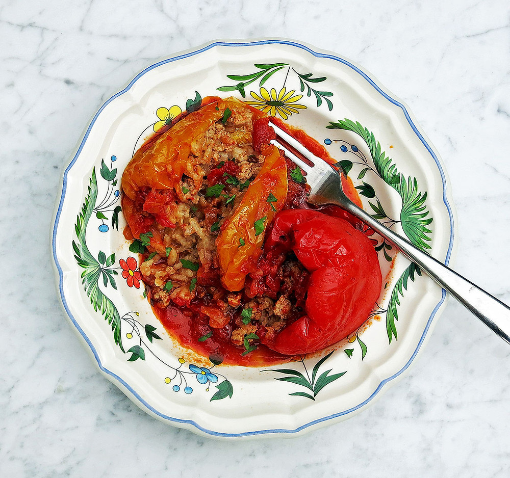 Peppers stuffed with veal, pork and rice in a rich tomato sauce