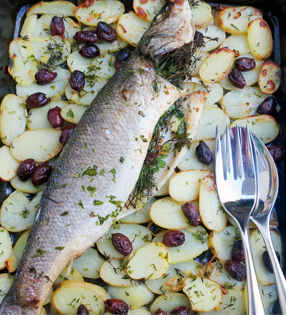 Roast Sea Bass with potatoes, black olives, thyme and parsley