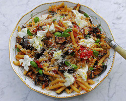 Pennette pasta with baby plum tomatoes, aubergines, mozzarella di bufala and basil