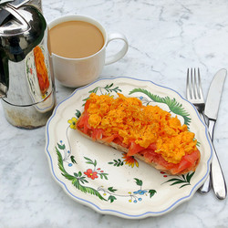 Soft scrambled eggs with smoked salmon on sour dough toast