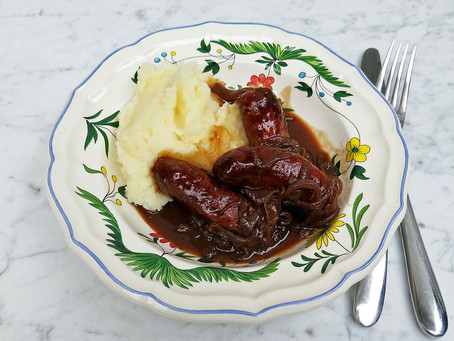 Sausages in a red wine onion gravy with mash potato
