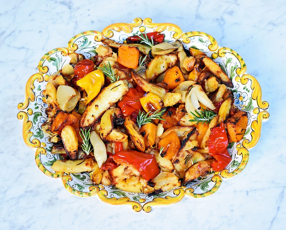 Roast potatoes, squash, pepper, tomatoes and onions with garlic, rosemary & olive oil