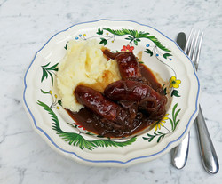 Sausage, mash and red onion gravy