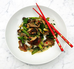 Coconut beef with spring onions and shiitake mushrooms