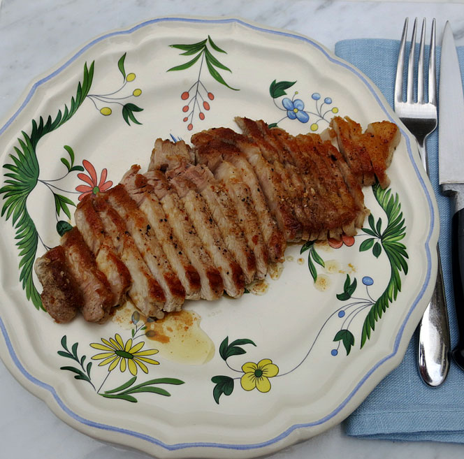 Pan fried rib eye pork steak