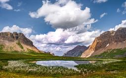 See mit Wollgraskreis SAnetschpass mit Wolken_Z624608-Signet-web.jpg