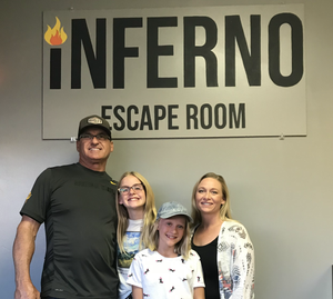 Family with father, photo outside an escape room