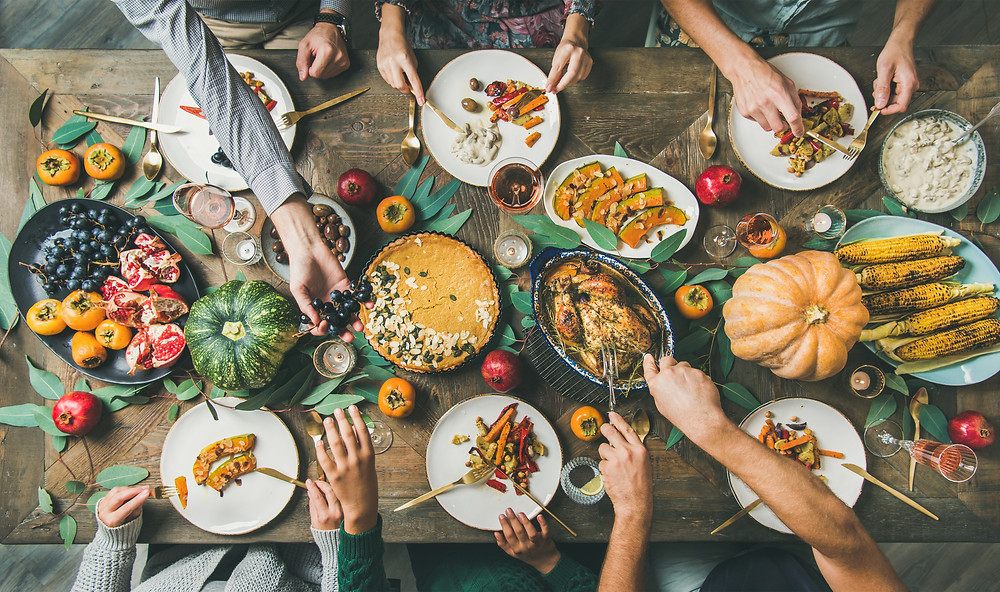 Thanksgiving things to do. Family and table of food.