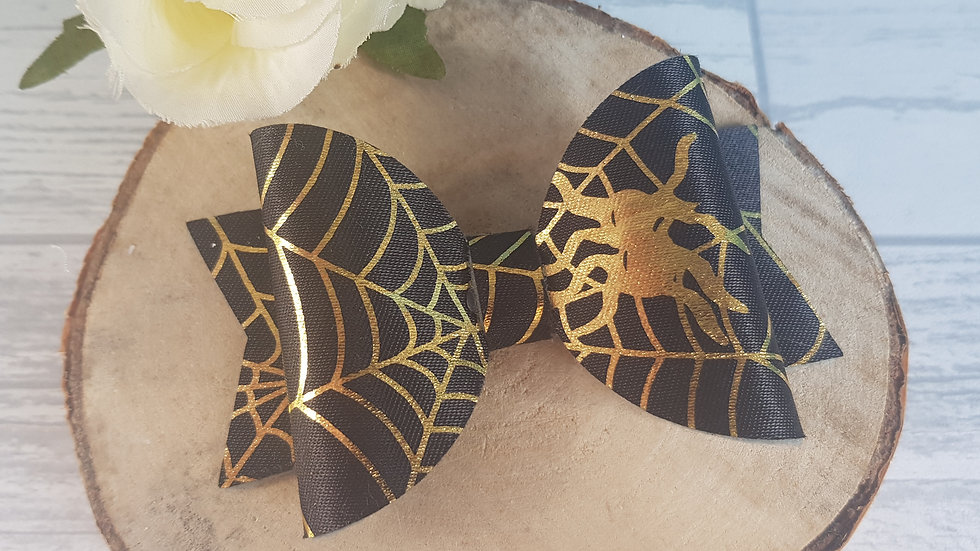 Gold spider web bow