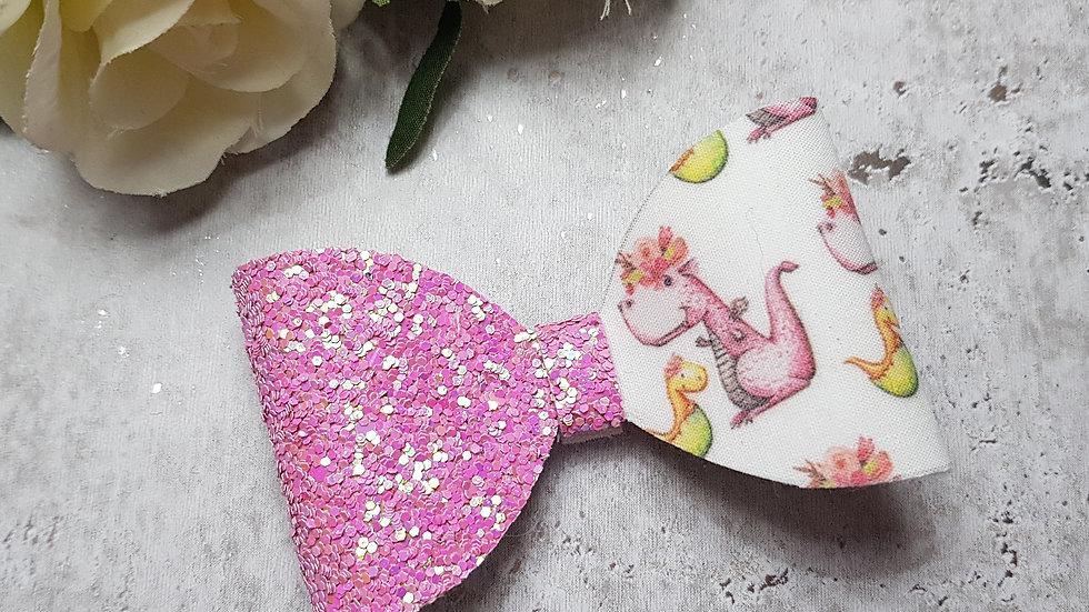 Pink dinosaur hair bow