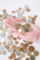 person-holding-silver-and-gold-coins-394