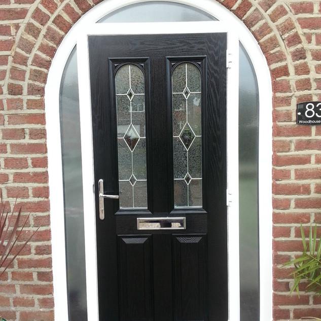 Black arched composite door
