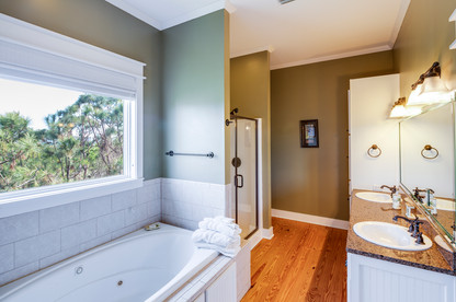 The huge master bathroom has double sinks and a big, jetted garden tub