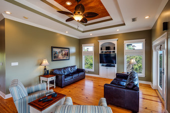 The beauitful living area has plenty of room to watch TV, a movie or just hang out.