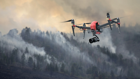 drone-with-camera-flying-over-forest-fire.jpg