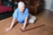 elderly woman fallen down on livingroom